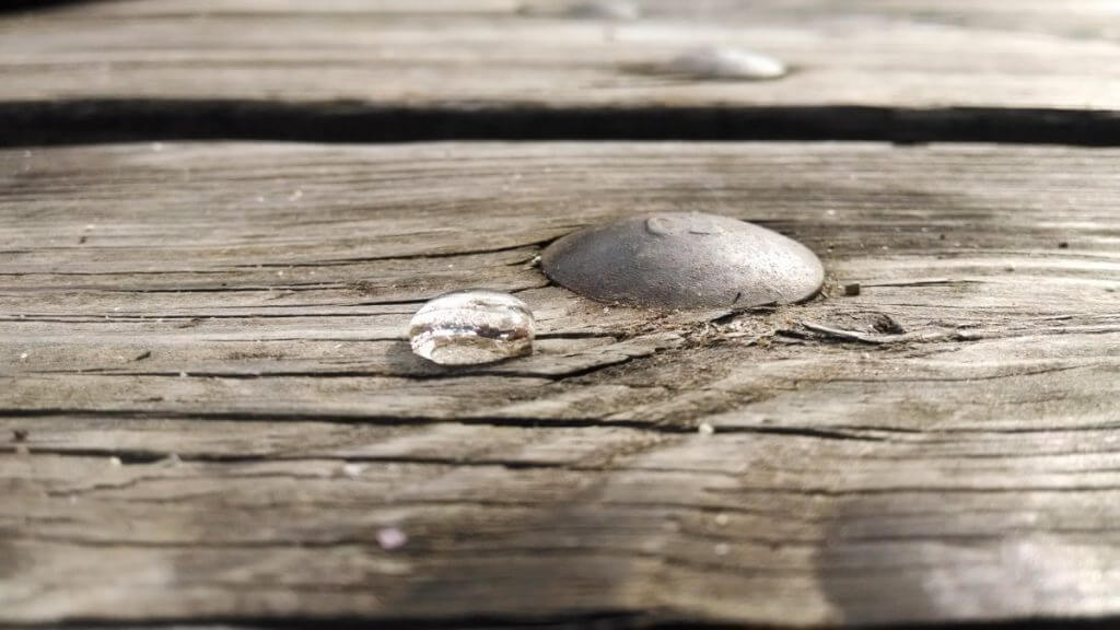 A drop of rain on a wooden table